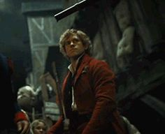 Enjolras (GIF) OMG HE EVEN MAKES PUTTING A GUN AWAY LOOK HOT. HE EVEN MAKES DRINKING WAT LOOK HOT. HE COULD EVEN MAKE THE MOST UNATTRACTIVE THIS EVER LOO HOT.