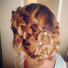 Water Fall Braid into a French braid with pinned back curls.