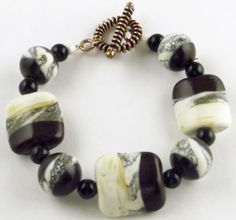 Brown and Ivory Lampwork glass beads used to make this bracelet.  I added silver ivory as an accent.
