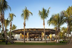 Encanto, the beachfront restaurant at the resort's Beach Club, is a fanciful take on mid-century modern circular motifs.