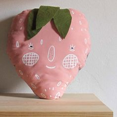This is a sweet strawberry plushie named Mrs. Berry. She has a silkscreen printed face. Each plushie is hand printed on 100% pink cotton front