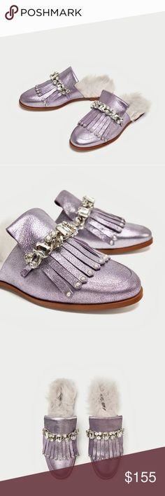 """ZARA Metallic Leather FAUX FUR Mules Slides 37 Flat mules in mauve purple leather with a metallic finish.  They feature bejewelled fringe on the instep, faux fur insoles and contrasting-coloured soles.  Brand new with tags! Sold out! Comes from a smoke-free home.   BRAND: Zara.  Genuine leather, rhinestones, faux fur.   SIZE: 37.  OUTSOLE LENGTH: 10"""". OUTSOLE WIDTH: 3.5"""". HEEL: 0.6"""". Zara Shoes Mules & Clogs"""