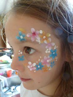 flower cheek art face paint design by elvira Pikachu Face Painting, Girl Face Painting, Feather Painting, Face Painting Designs, Stencil Painting, Paint Designs, Body Painting, Face Paintings, Lion Face Paint