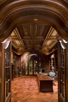 Coffered ceiling and rich woods create an extraordinary home office.