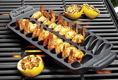 """Use this cast iron shrimp grill and serving pan to cook shrimp on the barbie, and you'll have a much better chance of eating shrimp off the barbie. The sturdy slab has cutouts for up to 22 jumbo shrimp, which it says it will grill to perfection in a """"p Best Grill Pan, Cast Iron Grill Pan, Best Grilled Shrimp Recipe, Ways To Cook Shrimp, Shrimp On The Barbie, Bbq Rotisserie, Large Bbq, Bbq Accessories, Grilling Tips"""