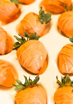 Strawberries dipped in orange chocolate to look like carrots for Easter. An Easter A Bunny Would Love