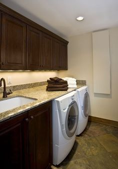 This is similar to what our laundry room will be, except I will have a bar to hang clothes over the sink. Ours will also be less formal- bright colored walls with white cabinets.