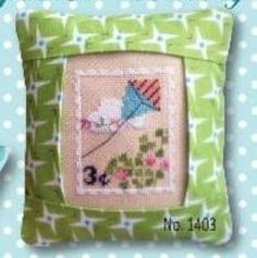 From Pine Mountain, March Special Delivery is this kit that contains the pre-sewn pillow, aida fabric, DMC fibers, pattern and needle.