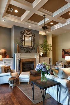 LIVING ROOM: Brown and Blue color scheme; ceiling; decor in general is heavenly!