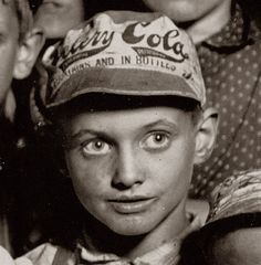 What's that on his hat? Celery-Cola! Check out the script. Yes, another Coca-Cola imitator. Hat worn by a newsboy in Indianapolis, August 1908.