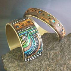 Beautiful mosaic polymer clay bracelet by Liz Hall (LizardsJewelry). ai LOVE the faux stones and wood! I would buy this in a heartbeat!!