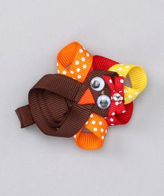 Add festive fall flair to any hairdo with this perky turkey. A sturdy clip base slides into tresses and stays put, so this polka dotted piece can share its silly splendor all day long.