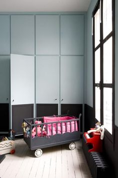Multifunctional built-in kids room storage, using black chalk paint on the lower half for spontaneous art work.