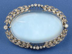 Antique Moonstone and Diamond Brooch, the moonstone cabochon framed by rose-cut diamond garland motifs, millegrain accents, wd. 2 1/8 in., rhodium-plated gold mount, boxed.  Edwardian or Edwardian style.