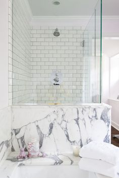 bathroom.  white subway tile, classic fixtures, glass shower.