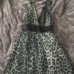 Grey leopard dress-mini Grey leopard mini dress that ties in the back. I wore it three times. Twenty one Dresses Mini