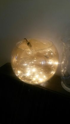 Fairy lights and organza in a glass fish bowl, lovely soft lighting to add a warm glow to a dark area of a room.