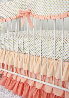 Coral and Gold Dot Ruffle Bumperless Crib Bedding. I'd love this as a bed skirt and sheets for Noelle!