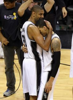Tim Duncan #21 hugs Danny Green #4 of the San Antonio Spurs after the Spurs 114-104 victory against the Miami Heat during Game Five of the 2013 NBA Finals at the AT Center on June 16, 2013 in San Antonio, Texas.