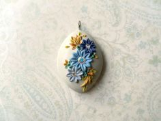 polymer clay applique | Composition in blue polymer clay pendant by DandelionJewellery
