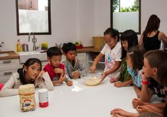 The children are taking it in turns to mix the ingredients.