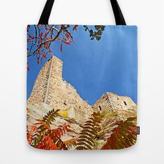 Autumnally castle Tote Bag by Pirmin Nohr - $22.00 Photography of a castle ruin in my homeland, the Palatinate in Germany. The leaves are from staghorn sumach, which grows in masses along one side of that big ruin.   blue sky, orange, red, historical building, autumn, fall, Dahn, Grafendahn, Pfalz, architecture, medieval