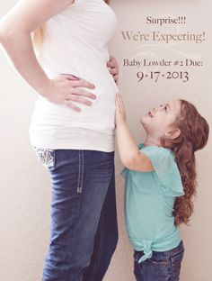 Very cute pregnancy announcment photo of mommy and daughter for second child   Photo copyright Ashley Lowder Photography
