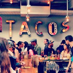 For some tasty tacos (and margaritas) visit Big Star in Wicker Park. It's right off the Blue Line Damen stop. It's cheap and always a fun atmosphere.