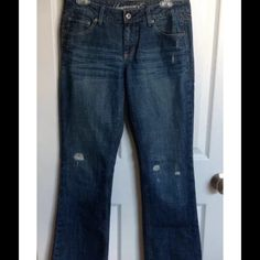 """American Eagle jeans True Boot style.  Destroyed/distressed denim.  Waist- 32"""", Inseam- 31 1/2"""", Rise- 8"""". 100% cotton American Eagle Outfitters Jeans Boot Cut"""