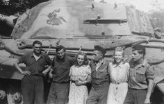 An original photo of German soldiers and lady friends posing beside a King Tiger tank from the 505th Heavy Tank Battalion.