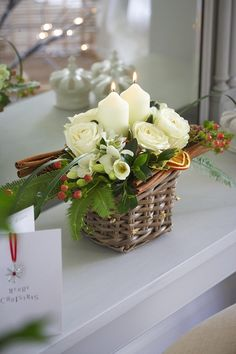 flowers and candlelight in a basket for the holidays