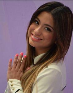 Ally Brooke Hernandez praying and smiling