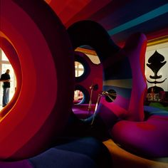 In the late 1960s and early 1970s, Verner Panton experimented with designing entire environments: radical and psychedelic interiors that were an ensemble of his curved furniture, wall upholstering, textiles and lighting.