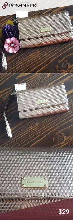 """Anne Klein Rose Gold Clutch Wristlet Wallet -NWT  -Multi Compartment Clutch with Rope Handle. -Hexagon Rose Gold Embossed Design -Features Large Middle Compartment, big enough for phone or checkbook. -This is a brand new, never used product but I did notice a *Very minor mark on the front. See picture #5.  6.75""""x4.5"""" 1.25"""" Thick  7"""" Wristband Anne Klein Bags Clutches & Wristlets"""