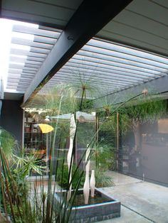 atrium ideas.... whispie greens with metal sculpural vases....