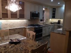 Warm kitchen with Ivory cabinets and Solaris granite