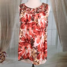 Dana Buchman Flowered Print Summer Blouse Today, featuring in Kaki Jo's closet is this beautiful flowered summer top.  New condition.  Size M. Dana Buchman Tops Blouses