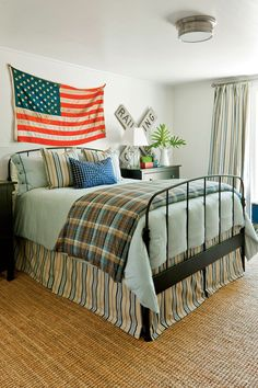 Keep beds simple. A black metal bed from IKEA is a modern version of an antique iron bed.  Ground a space with texture. Jute rugs go well with wood floors and don't detract from the furnishings.  Editor's Tip: Vintage items hung as art add one-of-a-kind Americana style.  See More of this Room