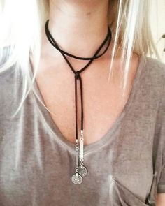 Check out this item in my Etsy shop https://www.etsy.com/listing/450650496/black-leather-choker-with-coin-pendents