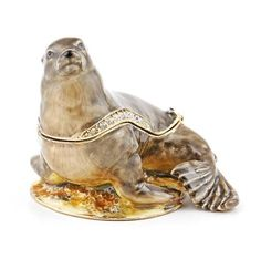 """California Sea Lion Hinged Trinket Box Item No. KB00220A01 $30.09 This Faberge style trinket box is constructed from a pewter base. The box is hand enameled, and decorated with Austrian crystals. This box is hinged, and features a magnet for a clasp. The magnet enables the box to open easily, but close firmly. The box is great just for display, for holding or giving as a gift a small piece of jewelry, or for some of your memorable items. Austrian Crystal, Trinket Boxes, Pewter, Lion, How To Memorize Things, Great Gifts, Base, California, Display"