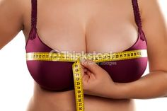 Stock Photo : woman measured her breast with a measuring tape