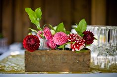 This is a great idea - could use tiny potted plants instead of cut flowers.