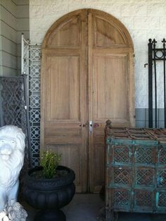 Arched, double doors. Light natural wood.  Maybe cypress. About 9' tall.  For our front coat closet.