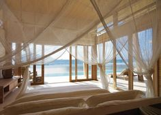 A bedroom suite with an all surrounding beach view, Six Senses Con Dao Resort in Vietnam designed by French based AW2.