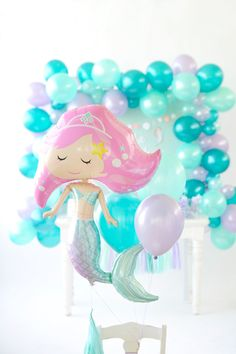 Mermaid balloons, galore! Tie balloons to the back of any chair to add some detail to your party decor. Mermaid Party styling by Happy Wish Company. Photography by Tammy Hughes Photography. Stationery by Minted artist, Bonjour Paper.