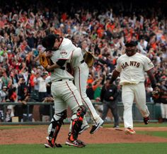 Tim Lincecum bearhugged by Hector Sanchez after completing a no-hitter against the Padres 6.25.14