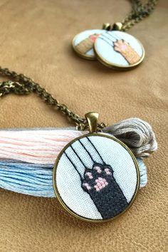 Artículos similares a Cat paw pendant/ Cross stiched jewellery en Etsy Hand Embroidery Art, Cross Stitch Embroidery, Embroidery Patterns, Cat Cross Stitches, Cross Stitching, Cross Stitch Designs, Cross Stitch Patterns, Mini Cross Stitch, Cat Paws