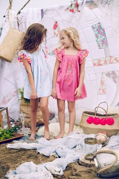 The Chloe Dress is sure to catch your eye- with its vibrant print and breathable material; perfect for your little one. The unique fabric and boho-chic embroidery are sure to be a memorable addendum to your summer memories.