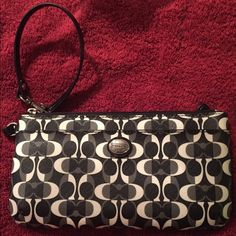 Coach Black and White Wristlet Coach Black & White Wristlet - authentic with strap and back zipper area for change. Coach Bags Clutches & Wristlets