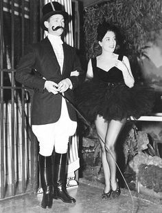 Joan Crawford!  And she has a run in her tights… in a black tutu! I love it :-)